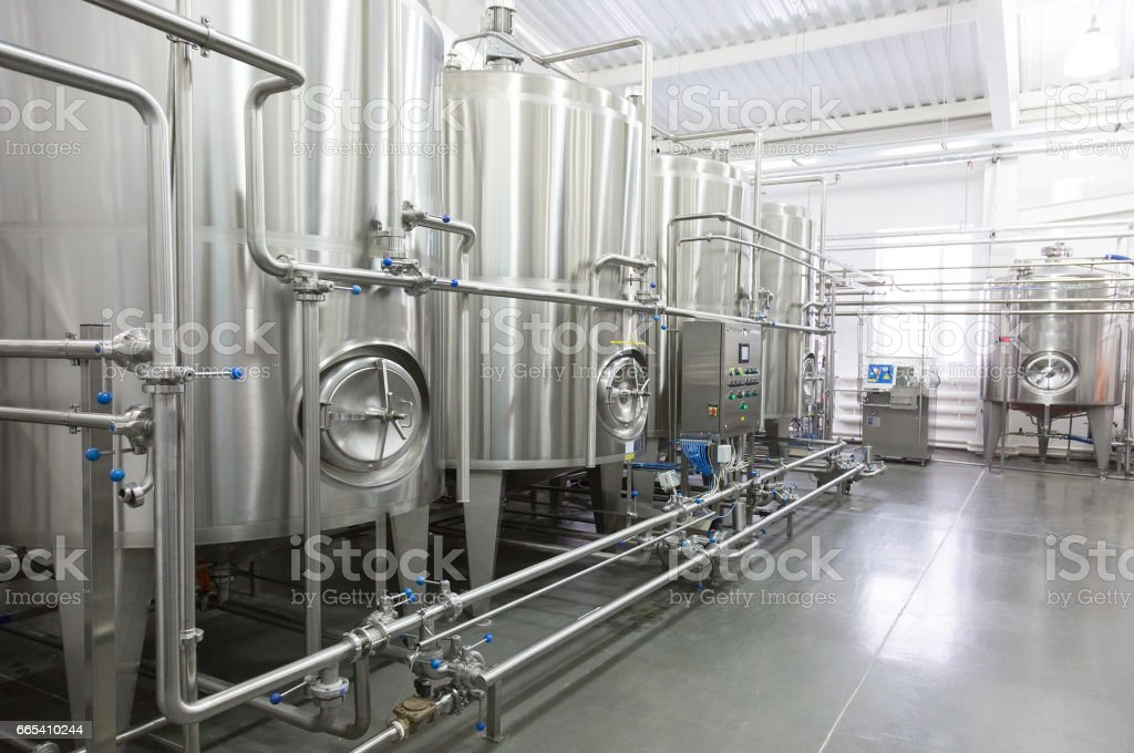 Technological equipment in modern  dairy plant stock photo