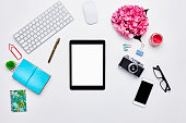 Technologies and office supplies on white background