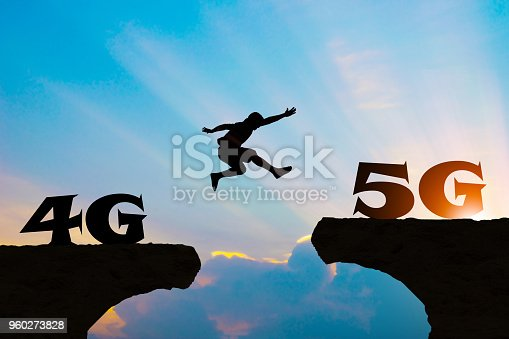 istock Technology 4G go to 5G Men jump over silhouette 960273828