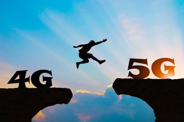 Technology 4G go to 5G Men jump over silhouette stock photo