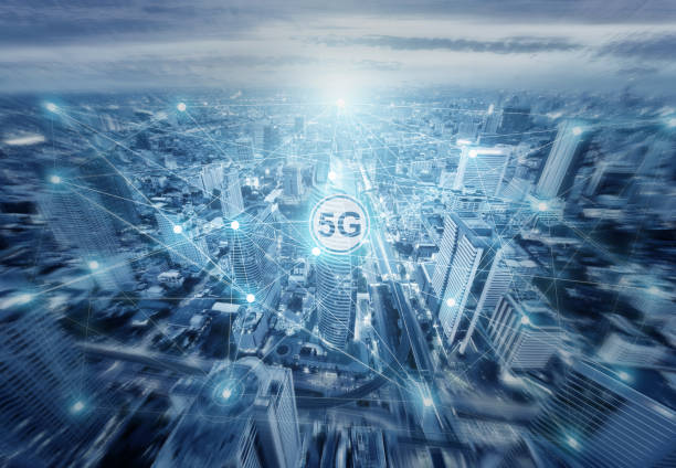 Technology 5G internet network illustration drawing onto aereal view of city skyline in light blue tone.