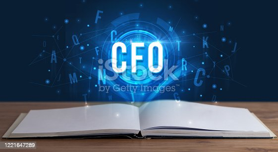 CFO inscription coming out from an open book, digital technology concept