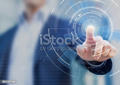 istock Technology abstract background with person hand touching complex circular diagram on virtual screen with copy-space, innovation, network, big data and internet concept 983457142