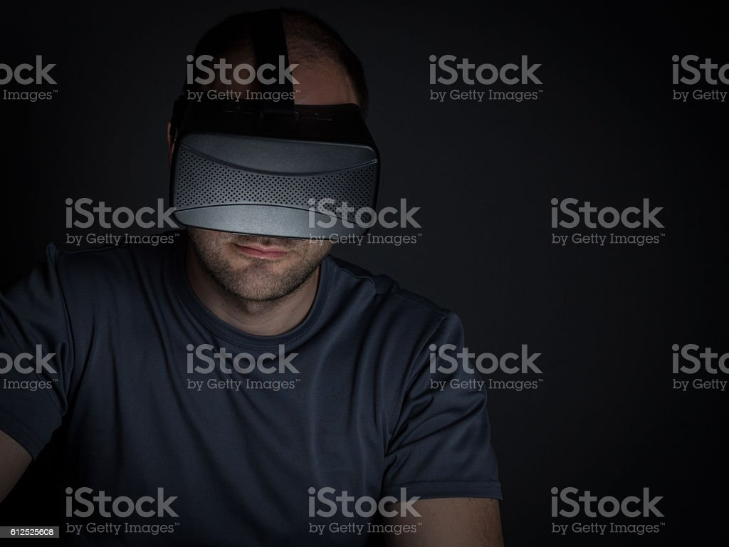 Technology addicted man at home at night on using stock photo