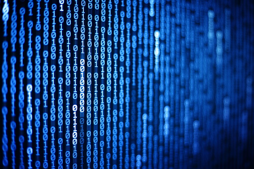 istock Technology Age. binary code information bit on computer monitor screen display. Blue light text number one and zero. blur defocus blue bokeh light. technology graphic design background concepts 984751532