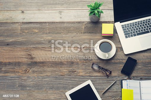 istock Technology and coffee on a wooden table. 483731108