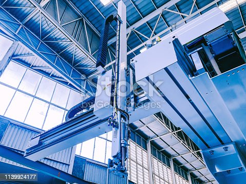 istock technology and industry 4.0 revolution concept from high precision robotic system control set up at top of injection machine 1139924177