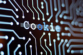 Technology Background and Circuit Board With Cookie Message. Close-Up Computer Screen And Computer Terms Concept. Horizontal composition.