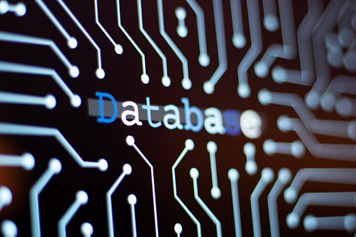 Technology Background and Circuit Board With Database Message. Close-Up Computer Screen And Computer Terms Concept. Horizontal composition.
