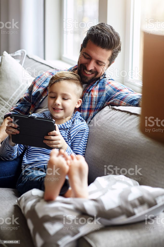 Technology can be a beneficial learning tool for kids too - Royalty-free Adult Stock Photo