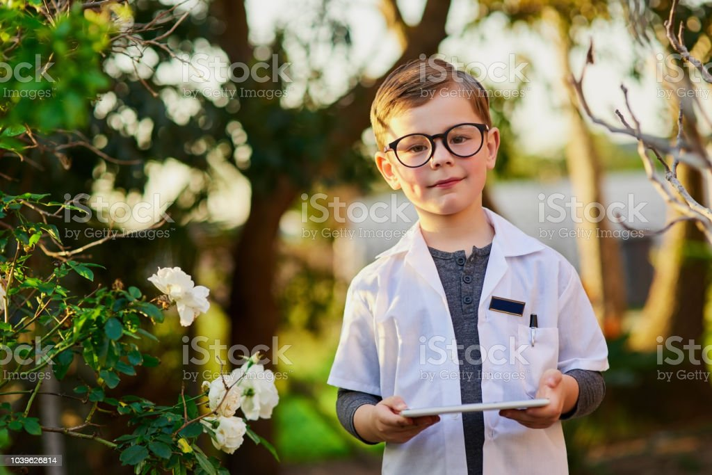 Cropped shot of an adorable little boy pretending to be a scientist...