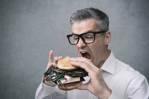 technology enthusiast - eating technology stock photos and pictures