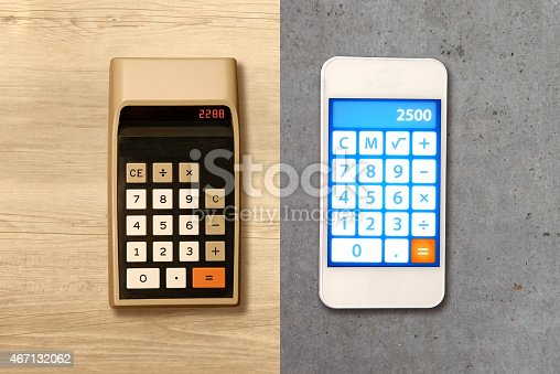 istock Technology evolution: comparing smartphone with a calculator from the seventies 467132062