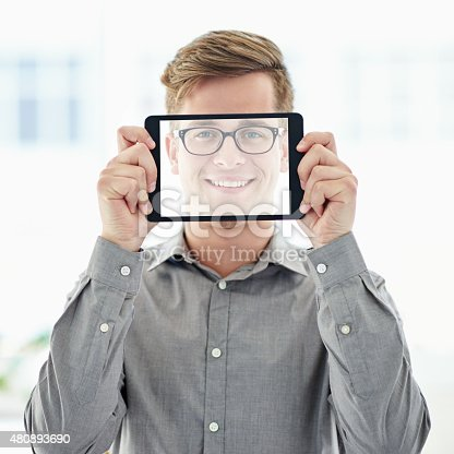 A young man holding a digital tablet with a transparent screen in front of his facehttp://195.154.178.81/DATA/i_collage/pu/shoots/805192.jpg