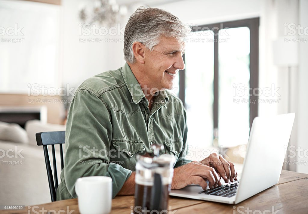 Technology has become a part of his morning routine stock photo