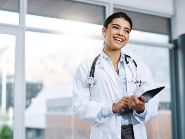 Technology has become such a vital component to the medical field Shot of a young female doctor using a digital tablet in a hospital female doctor stock pictures, royalty-free photos & images