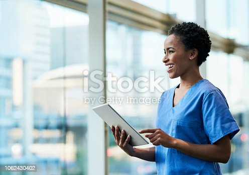 Shot of a young medical practitioner using a digital tablet in a hospital