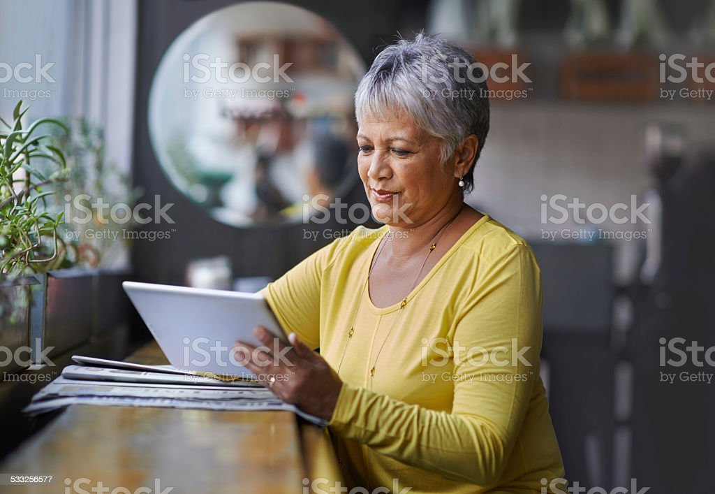 Technology helps her keep in touch with friends stock photo