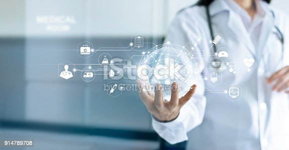istock Technology Innovation and medicine concept. Doctor and medical network connection with modern virtual screen interface in hand on hospital background 914789708