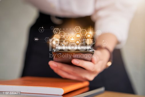 1155191162 istock photo Technology innovation concept, business woman holding smartphone and press digital icon with mixed media. 1191330471