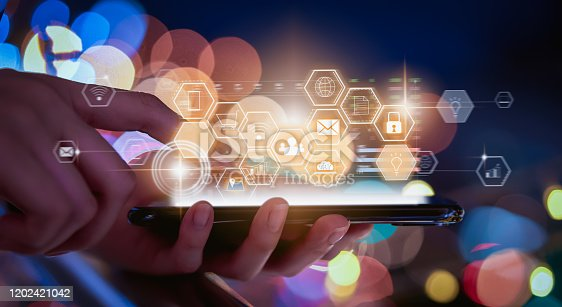 1155191162 istock photo Technology innovation concept, hand holding smartphone and press digital icon with mixed media on bokeh colors light in night atmospheric city. 1202421042