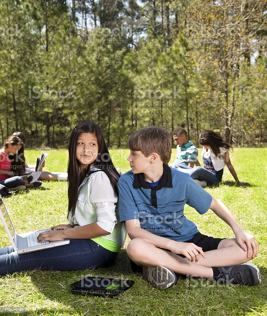 Technology:   Junior high students using laptop and tablet computers royalty-free stock photo