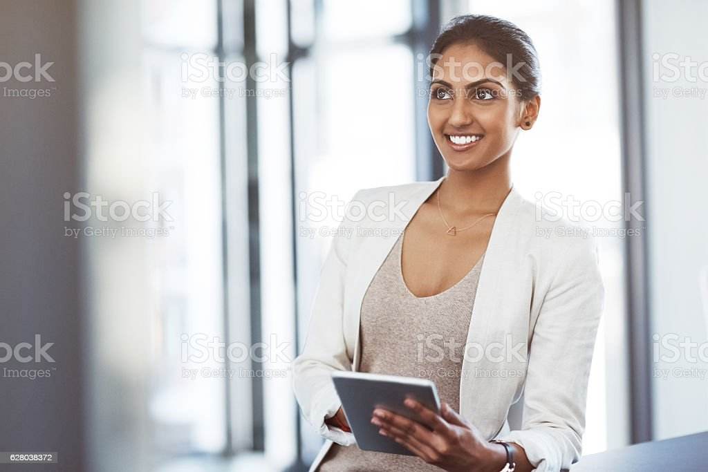Technology that supports her business vision stock photo