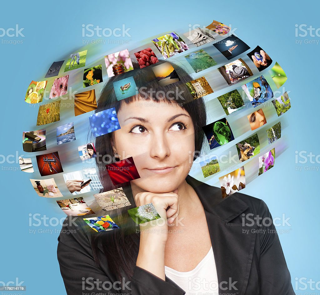 technology woman has images around his head. royalty-free stock photo