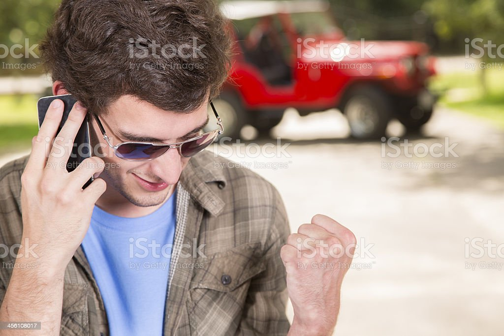 Technology:  Yes!  Man on phone excited about good news. royalty-free stock photo