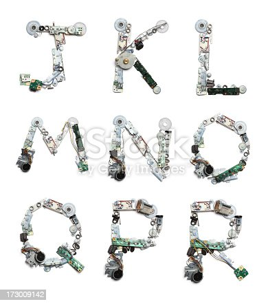Alphabet letters built out of disassembled mechanical objects, wires and circuit boards.