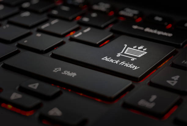 teclado negro black friday Teclado negro con icono de eshopping  black friday en la tecla enter, detalle black friday stock pictures, royalty-free photos & images