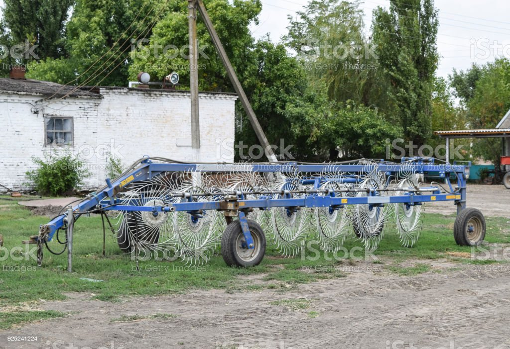 Tedder on trailer for tractor. The machine for gathering hay. stock photo
