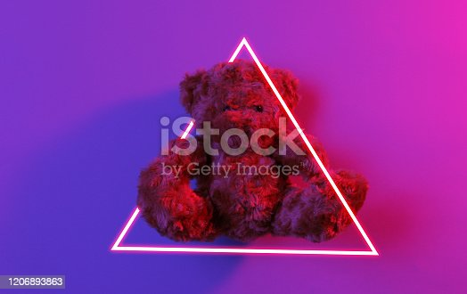 istock Teddy bear. 80's synth wave and retrowave glowing triangle futuristic aesthetics. Old fashioned abstraction concept 1206893863