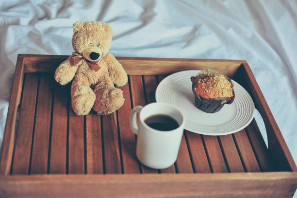 Teddy Bear and breakfast in bed stock photo