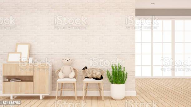 Teddy bear and cat on chair in living room or kid room interior for picture id874186790?b=1&k=6&m=874186790&s=612x612&h=i o7brcvvhho6xew1qrbe6qp08knehhaezwh0up9qv4=