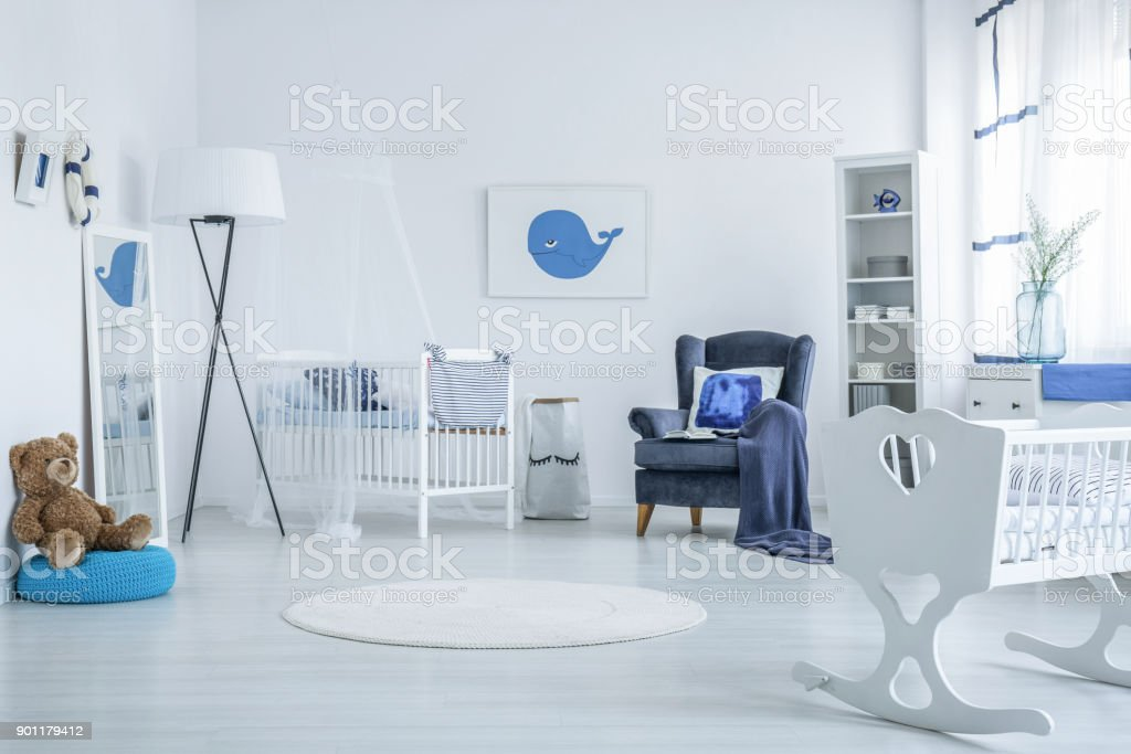 Teddy bear in kid's bedroom stock photo