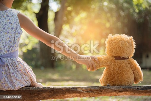 istock teddy bear is a best friend for all little cute girl. Child autism can be more happy and fun when they're play in family. Feel love and care. Family Friendship Concept. 1006485842