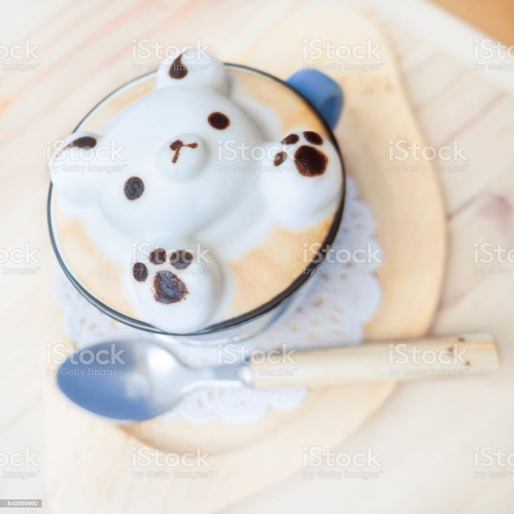 teddy bear milk foam on hot latte stock photo