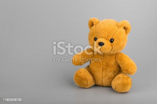 Teddy bear on grey background copyspace