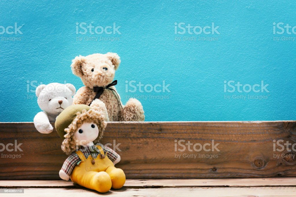 teddy bear on old wood ,blue wall background. - Royalty-free Backgrounds Stock Photo