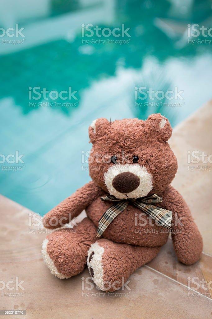 Teddy bear sitting alone stock photo