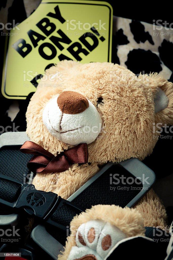 Teddy bear sitting in car seat stock photo