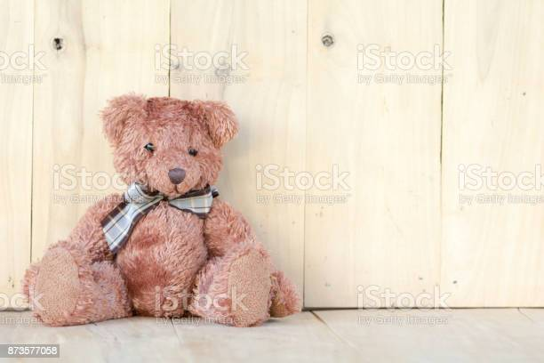 Teddy bear sitting on the wooden floor picture id873577058?b=1&k=6&m=873577058&s=612x612&h=y zfkijxq6c t8z 1n1ii9mvzy 0yilp6d0stl5uwqw=