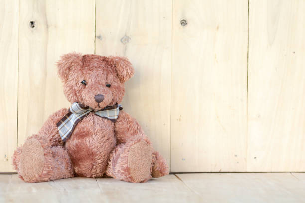 Teddy bear sitting on the wooden floor picture id873577058?b=1&k=6&m=873577058&s=612x612&w=0&h=vhc7u4uvg6ybebx5xhhtjfquopmz6jmp2wqk3tbmnbs=