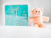 Teddy bear toy and clock in the bedroom