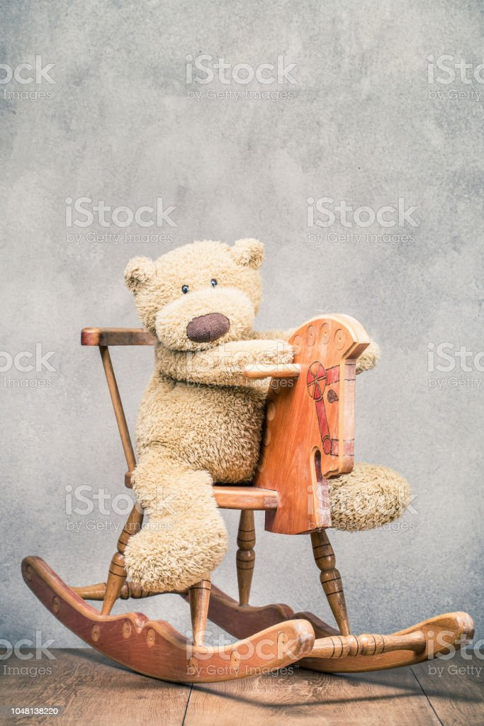 Teddy Bear Toy Sitting On Old Retro Wooden Rocking Horse Front Concrete Wall Background Vintage Style Filtered Photo Stock Photo Download Image Now Istock