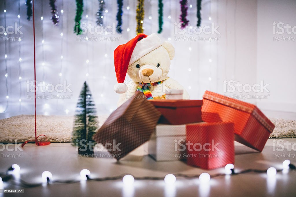 Teddy bear waiting for New Year stock photo