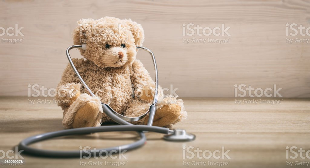 Teddy bear with a heart stethoscope stock photo