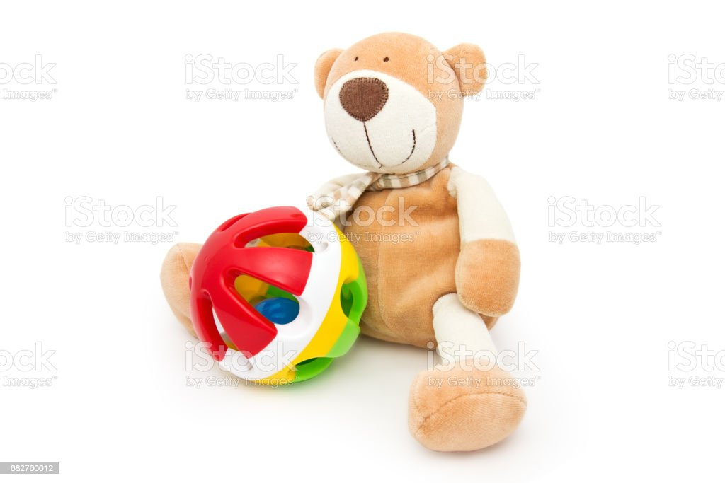 Teddy bear with a rattle. stock photo
