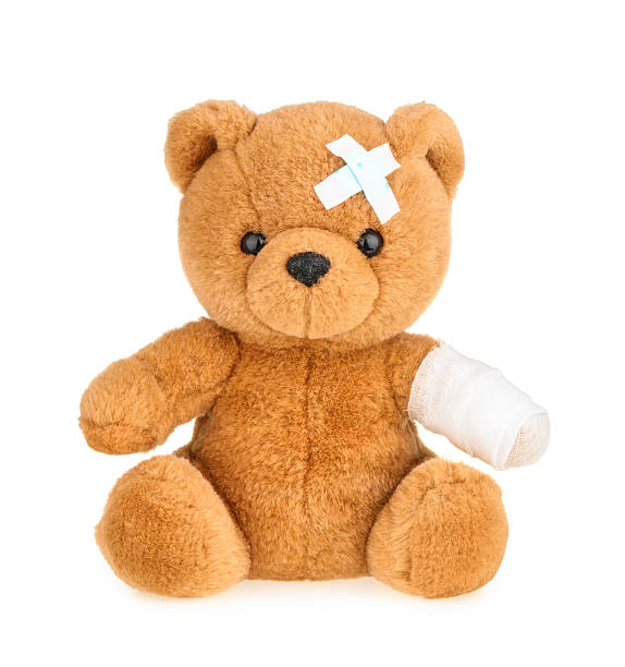 teddy bear with bandage isolated on white - teddy bear stock photos and pictures